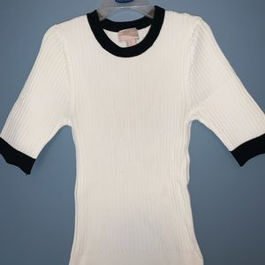 Stretchy top w black detailing at collar/sleeves.